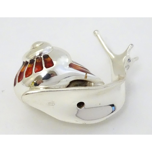 57 - A white metal model of a snail with enamel decoration to shell. Approx 1'' high...