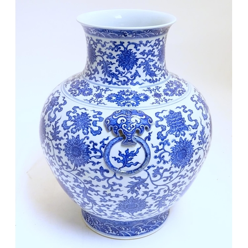 14 - A large Chinese blue and white vase, depicting scrolling lotus with shou character to centre flower,...
