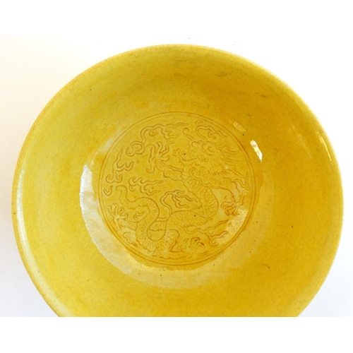 15 - A Chinese Imperial yellow glazed, incised dragon bowl , decorated with 5 clawed dragon and phoenix ,...