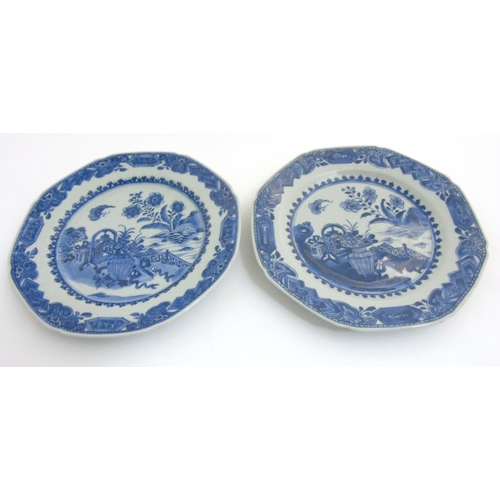 25 - Two Chinese blue and white octagonal plates with canted corners, having hand painted designs of flow...