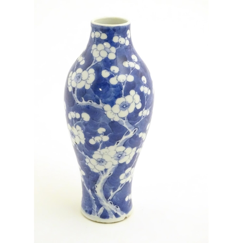 29 - A Chinese blue and white vase decorated with prunus, Chinese character marks to base. Approx. 10'' h...