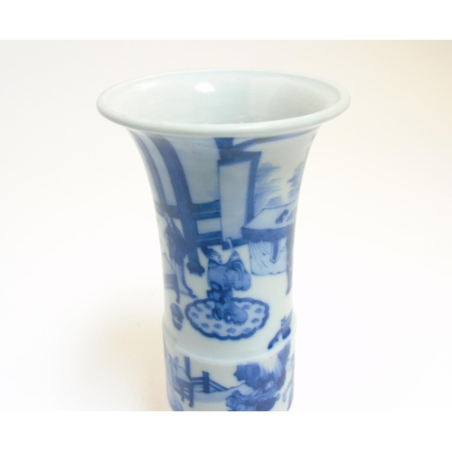31 - A Chinese blue and white Gu vase with underglaze blue decoration depicting imperials in a pagoda gar...