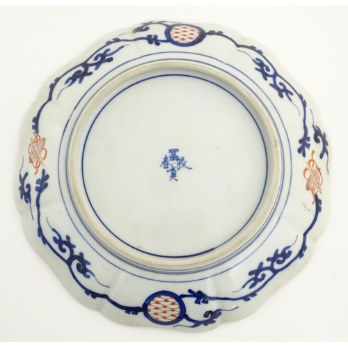 37 - Two Imari plates with waved edges and floral decoration. Largest approx. 12'' wide...
