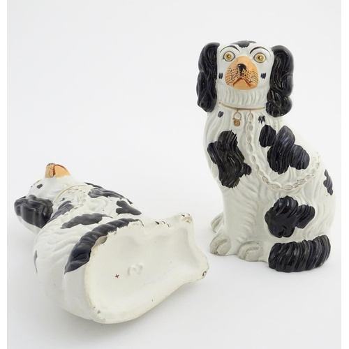 47 - Two Victorian Staffordshire seated spaniels with black patch decoration and gilt lock and chain deta...