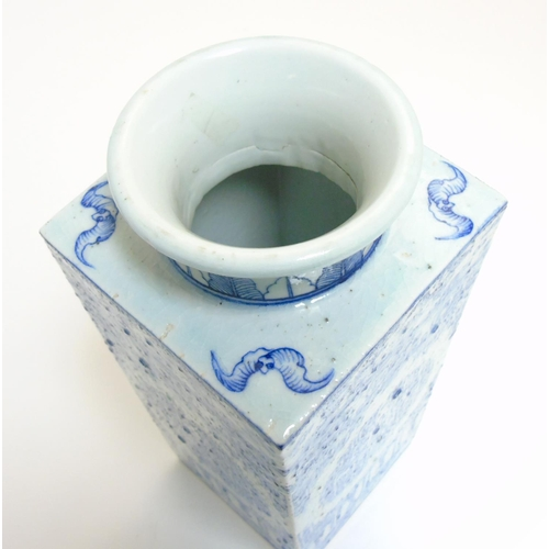 5 - A Chinese blue and white Cong shaped vase, having a tall square tapering body with flared circular n...