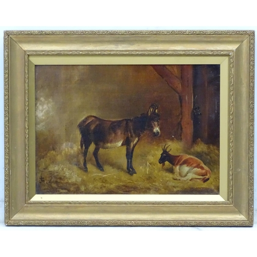 41 - JTW ( monogram ) XIX, Oil on canvas, A Donkey & Goat in a straw laden stable Signed lower left. 10 x...