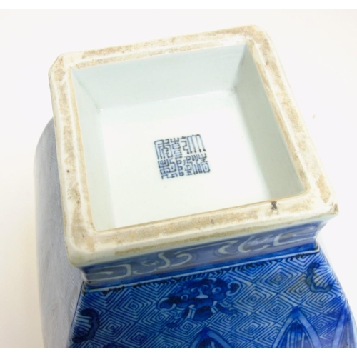 12 - A Chinese blue and white square section vase, with archaic style decoration , having waisted squared...