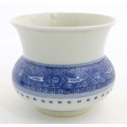 14 - A Chinese pot/vase of squat form, with a round body and a flared rim. Decorated with banded geometri...