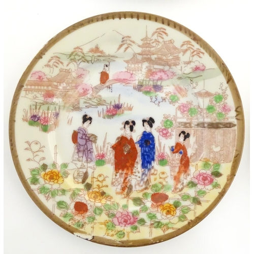 16 - Six Japanese plates depicting figures in traditional dress in an Oriental landscape depicting Mount ...
