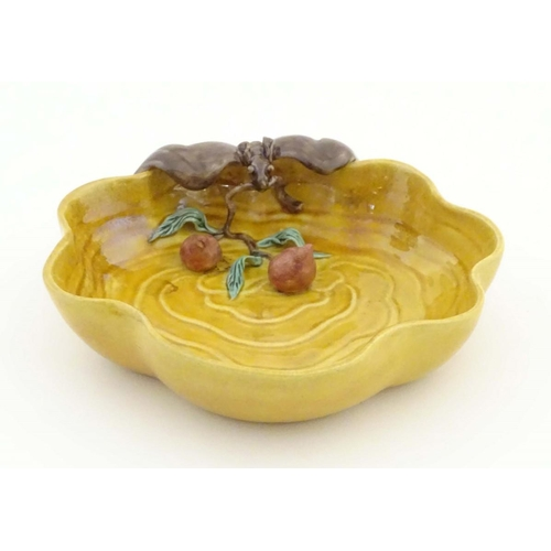 18 - A Chinese wavy edged yellow brush wash dish with bat and fruit decoration, Chinese character marks t...