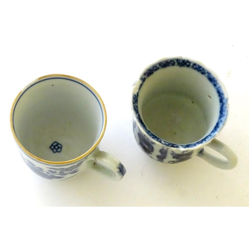 22 - Two Chinese blue and white teacups, one decorated with flowers and foliage, the other with figures. ...