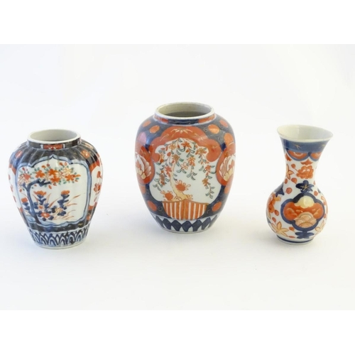 23 - Three Imari vases decorated with panelled floral designs. Largest approx. 5'' high (3)...