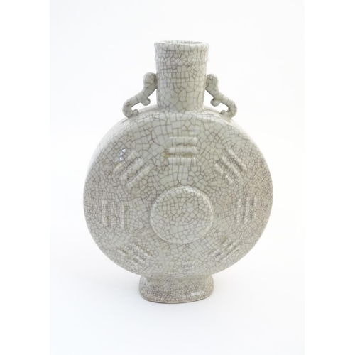 33 - A large Chinese crackle glaze celadon twin handled moon flask having central medallion surrounded by...