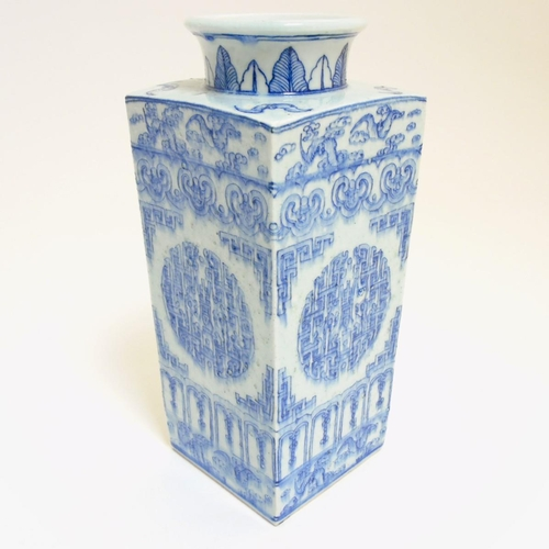 4 - A Chinese blue and white Cong shaped vase, having a tall square tapering body with flared circular n...