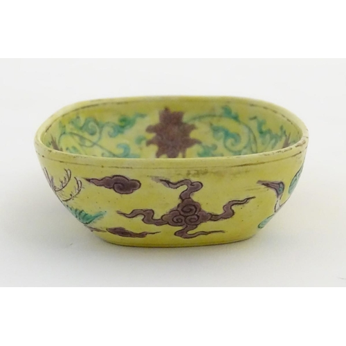 48 - A small Chinese dish decorated with stylised birds, clouds and flowers. Character marks to base. App...