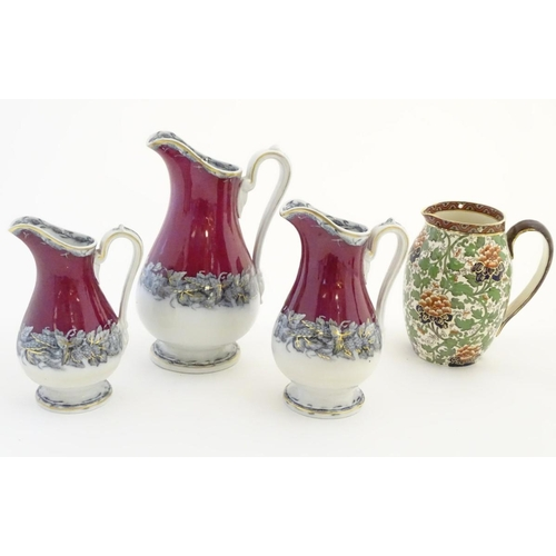 56 - A Royal Doulton jug decorated with a floral Arts and Crafts pattern with gilt highlights. Stamped Ro...