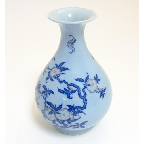 7 - A Chinese Yuhuchungping pear shaped vase with flared rim, decorated with peaches and bats in undergl...