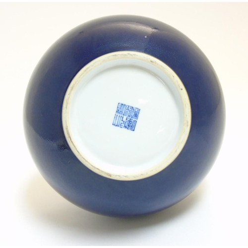 9 - A Chinese blue monochrome Shangping vase with globular body and flared rim, bears underglaze blue Ch...