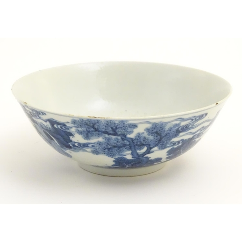 13 - A 19thC Chinese blue and white bowl depicting figures in a landscape. Approx. 2 3/4'' high x 7 1/2''...