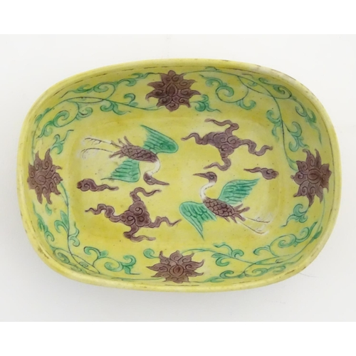 16 - A small Chinese dish decorated with stylised birds, clouds and flowers. Character marks to base. App...