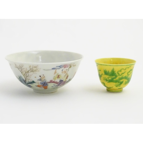 19 - A Chinese famille rose bowl depicting figures and a deer in a landscape. Character marks to base. Ap...