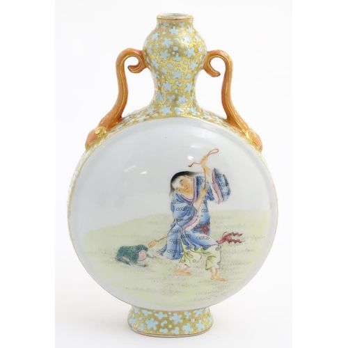 20 - A Chinese twin handled moon vase decorated on one side with a lady and a frog, and two figures on th...