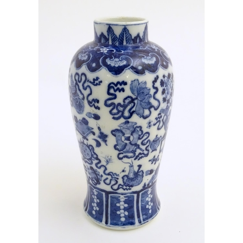 21 - A Chinese blue and white vase decorated with emblems of good fortune, including the chakra (flaming ...