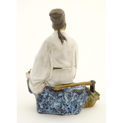 26 - A Chinese partially glazed ceramic mudman figurine depicting a scholar/scribe, thought to be Chung K...