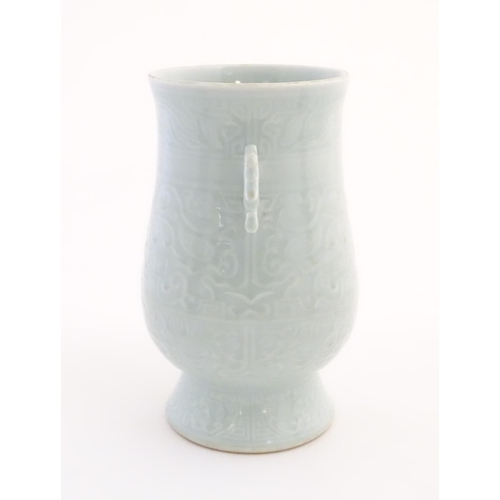 29 - A Chinese celadon 'Jun' shaped vase with scrolling handles, decorated with symbols and patterns. App...