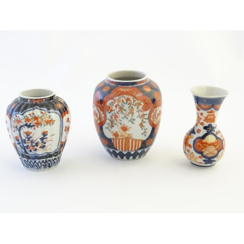 30 - Three Imari vases decorated with panelled floral designs. Largest approx. 5'' high (3)...