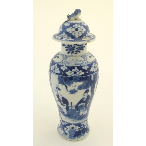 32 - A Chinese blue and white ginger jar decorated with a floral pattern and two panels depicting an elde...