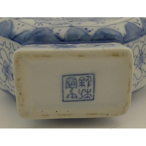 34 - Three assorted Chinese ceramics comprising a blue underglaze brush pot with a mountainous landscape,...