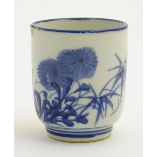 35 - A Japanese blue and white pot with hand painted floral and foliate decoration. Character marks to ba...