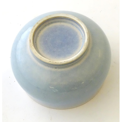 37 - An unmarked high fired blue glazed bowl. Approx. 3'' high....
