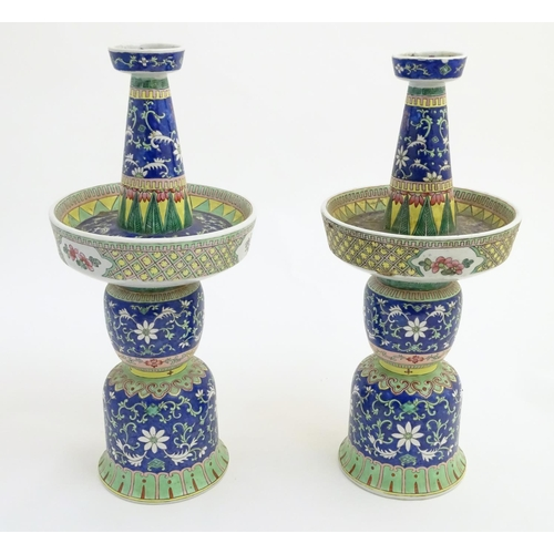 40 - A pair of two-sectional Chinese vases decorated with floral and foliate scrolls. Approx. 17 ¾'' high...