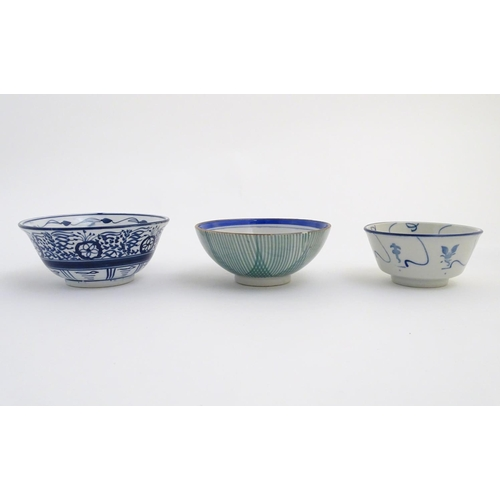 43 - A quantity of Japanese items to include two hand painted plates, one with a scalloped edge and panel...