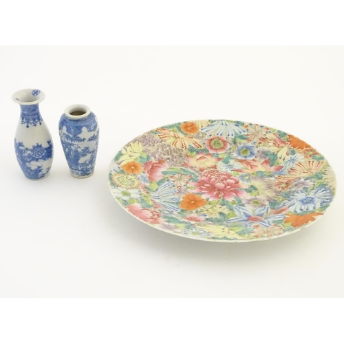 44 - An Oriental plate decorated with stylised flowers, with a scrolling floral design to reverse. Charac...