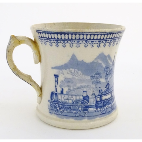 48 - A 19thC blue and white tankard decorated with a train 'JACO' in a landscape. Approx. 4 ½'' high....
