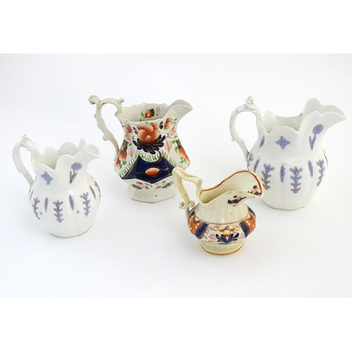49 - Four assorted Victorian jugs, two with floral / lavender decoration in relief, one in the Gaudy Wels...