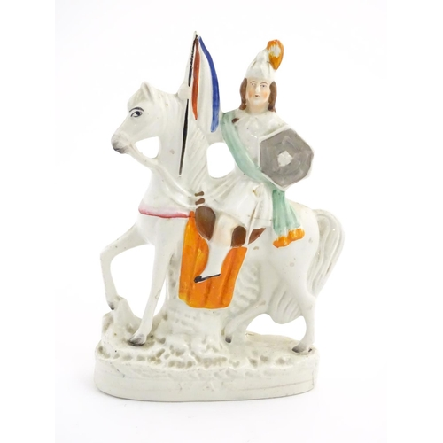 54 - A Staffordshire pottery flat back figure of a knight on horseback. Approx. 11'' high....