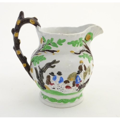 55 - A 19thC Staffordshire Pottery Pratt style jug, depicting figures in a landscape with dogs, a horse, ...