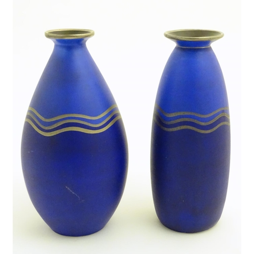 58 - Two blue studio pottery two-tone vases decorated with three gilt undulating bands, gilt rims and a b...
