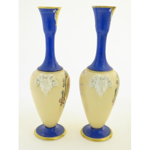 59 - A pair of vases with hand painted Roman portraits in roundels surrounded by scrolling decoration, an...