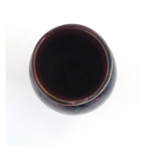 60 - A Baron Barnstaple pottery vase, with a high fired glaze. Marked under. Approx 5 1/4'' high....