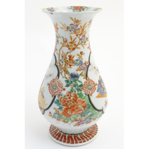 7 - A Japanese baluster vase with a flared foot and rim, decorated with two panel scenes depicting a you...