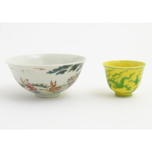 25 - A Chinese famille rose bowl depicting figures and a deer in a landscape. Character marks to base. Ap...