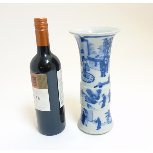 34 - A Chinese blue and white Gu vase with underglaze blue decoration depicting imperials in a pagoda gar...