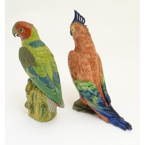 47 - Two ceramic models of exotic birds. One indistinctly marked under. Largest approx. 15'' high. (2)...