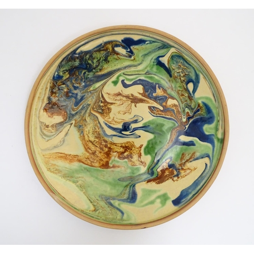 55 - Scandinavian Pottery: An Swedish Studio pottery dish in the style of Martin Andersson, decorated in ...