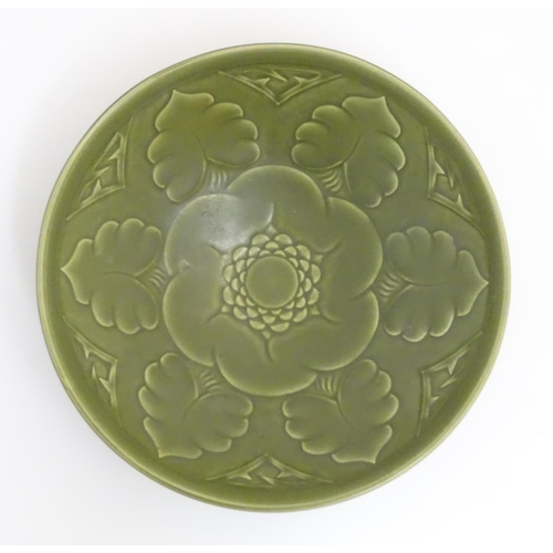 58 - Scandinavian Pottery: An early / mid 20thC Bo Fajans, Gavle, Sweden pottery dish , decorated with st...